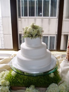 White Wedding Cake with Fresh Floral Topper