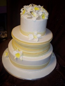 Yellow and White Wedding Cake with Sugar Orchids