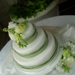 Green and White Wedding Cake with Fresh Flowers