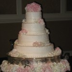 White Cake with Pink Hydrangeas and Polka Dots
