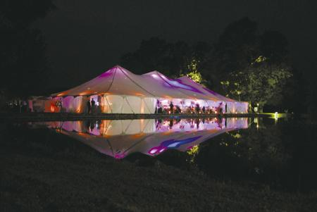 Wedding Reception Tent Lights Up The Night An outdoor wedding is an