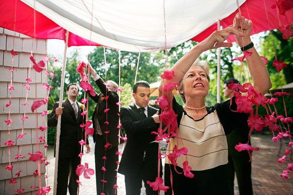 Flowers being strung for a chuppah