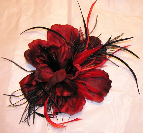 Feather fascinator with red flowers and feathers