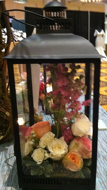 Lanter with flowers for wedding centerpiece1 Lanterns. Not Just for Candles Anymore!