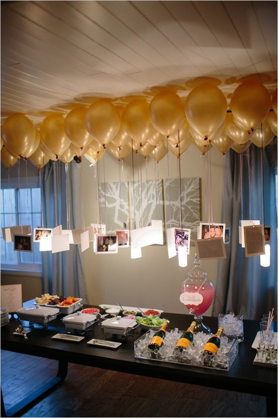 photos hung from ballons as backdrop 5 Fun Ways to Use Balloons at Your Wedding
